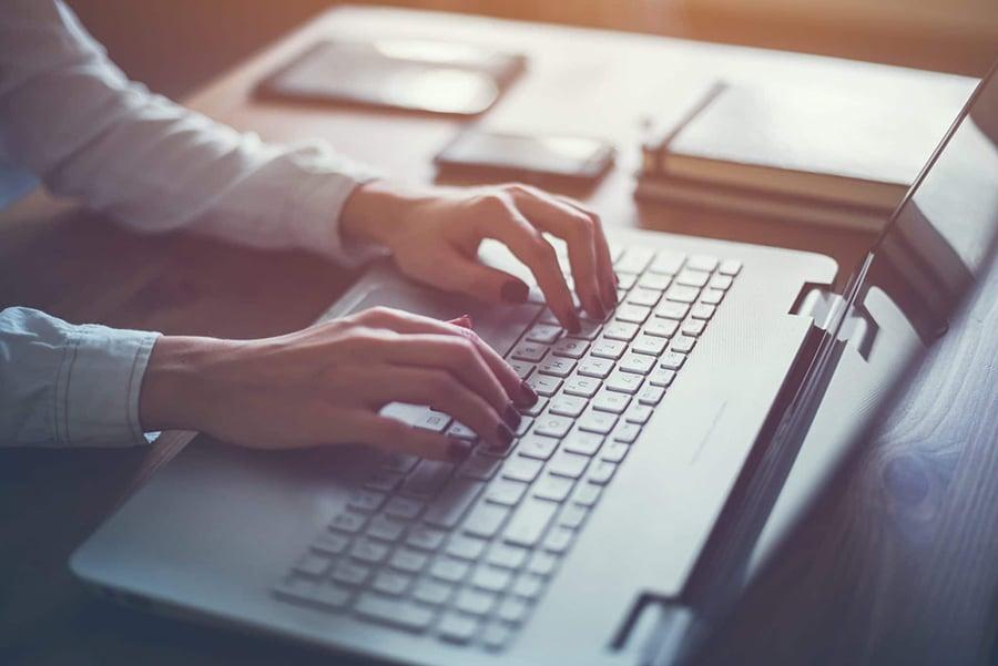 Lawyer blogging on laptop